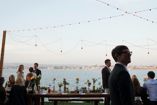 Daytime reception on the sand with string lights at The Garty Pavilion.